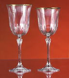 Crystal glasses. Two crystal glasses on red background Royalty Free Stock Photography