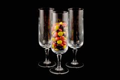 Crystal glasses with candy Stock Images