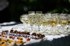 Crystal glasses of champagne for bride and groom Royalty Free Stock Photo