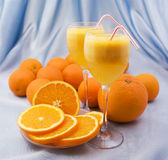 Crystal glasses of fresh orange juice Royalty Free Stock Photo