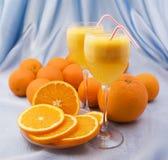 Crystal glasses of fresh orange juice. Two crystal glasses of fresh orange juice Royalty Free Stock Photo