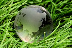 Crystal global on grass Royalty Free Stock Image