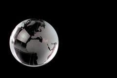 Crystal globe on black background Stock Photo