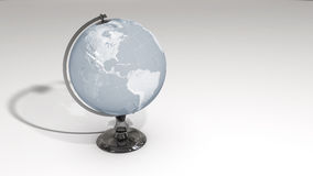 A crystal globe on a chrome pedestal over white Royalty Free Stock Image