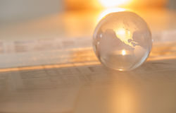 Crystal Globe On Financial Papers Stockbilder