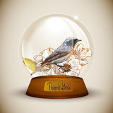 Crystal globe with flower and bird. Stock Images