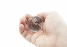 Crystal globe in hand Royalty Free Stock Images