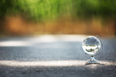 Crystal globe on the way, travel conception Royalty Free Stock Image