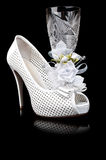 Crystal goblet and wedding shoe Royalty Free Stock Photos