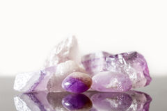 Crystal healing Stone amethyst, uncut and tumble finished. Concept therapie and engery Stock Images