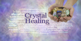 Crystal healing word cloud banner. Female crystal therapist offering a selection of crystals in a brass dish, surrounded by a relevant word cloud on an ethereal Royalty Free Stock Photography