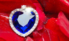 Crystal Heart and dew drops on roses Royalty Free Stock Image