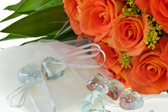 Crystal heart and orange rose Royalty Free Stock Image