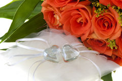 Crystal heart and orange rose 01. Flowers and jewelry for a Valentine`s Day stock photography