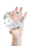 Crystal heart in two fingers Stock Images
