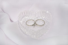Crystal Heart and Wedding Rings. Wedding rings inside a crystal heart Royalty Free Stock Images