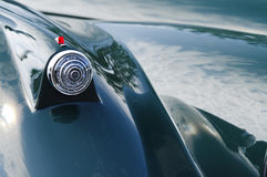 Crystal hood ornament on a green car fender Royalty Free Stock Photography