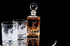 Crystal hunter. Crystal bottle and glasses hand engraved with image of bird hunter Stock Photos