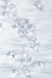 Crystal ice cubes on winter white fur Royalty Free Stock Images