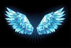 Crystal ice wings. Polygonal, sparkling wings of blue, clear ice on a blue background. Ice wings Royalty Free Stock Image