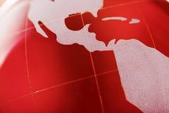 Crystal jordklot på röd bakgrund Royaltyfria Bilder