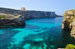 Crystal Lagoon in Comino - Malta. Clear blue seas surrounding the island of Comino in Malta Stock Photo