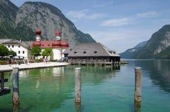 Crystal lake Konigsee with St. bartholomew church Stock Images