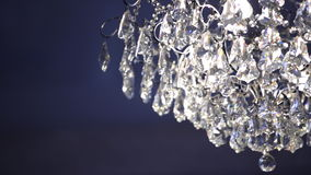 Crystal lamp shade on a blue background stock video
