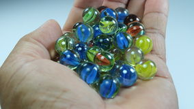 Crystal marbles on the hand Royalty Free Stock Image