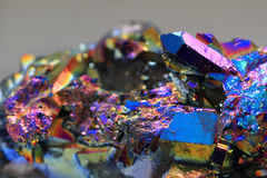 Crystal with metal rainbow surface Stock Photos