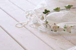 Crystal necklace, white floral tiara on toilette table Stock Images