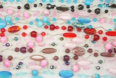 Crystal Necklaces. Wallpaper consists of glass beads with different shapes and colors on cotton stock photography
