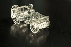Crystal ornament that is a Jeep model car on a black background in which it is reflected stock photos