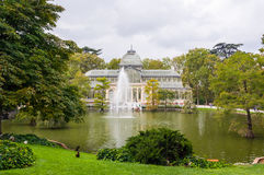 Crystal Palace in Buen Retiro Park, Madrid, Spain. MADRID, SPAIN - SEPTEMBER 27, 2014: Crystal Palace (Palacio de Cristal). Glass and metal structure located in Stock Photos