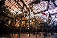 The Crystal Palace in Madrid. This is the Crystal palace located in the Retiro Park, in Madrid. You can see all the lights with your partner, take some beautiful royalty free stock photos