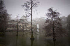 Crystal palace in Madrid. Crystal Palace in Retiro Park in a foggy day Stock Photos