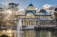 Crystal Palace on Retiro Park in Madrid, Spain. The Crystal Palace (Palacio de Cristal), a glass and metal structure built by Ricardo Velazquez Bosco in 1887 to Stock Photo