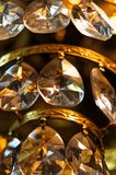 Crystal pendants. Crystal chandelier hanging on the old, like drops of rain. They play in the light like a rainbow. Their shine and glare create magic in the Royalty Free Stock Images