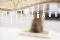 Crystal pendants at the end of the blind. Abstract blurred background Royalty Free Stock Photos