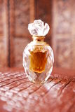Crystal perfume bottle. In romantic setting royalty free stock image