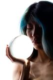 Crystal portrait. Semi silhouette of girl holding crystal ball stock photos