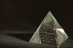 Crystal Pyramid. With Hieroglyphs on black background Royalty Free Stock Photography