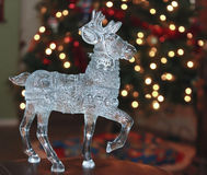 A Crystal Reindeer and a Christmas Tree Royalty Free Stock Image