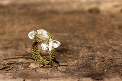 Crystal ring on an old wooden board Royalty Free Stock Photo