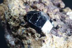 Crystal of rutile. In piece of ore Royalty Free Stock Photo