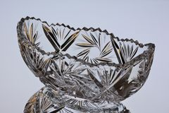 Crystal salad bowl with reflection on a gray background stock images