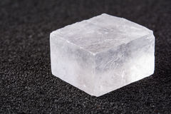Crystal of Salt. Crystal of mineral salt on a black background royalty free stock photography