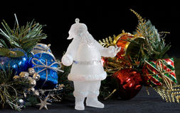 Crystal Santa. Frosted glass Santa with holiday deocorations Stock Images