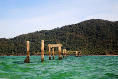 Crystal sea and ruin bridge post, Lipe Royalty Free Stock Photos