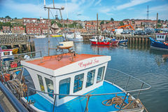 Crystal Sea Whitby. The harbor at Whitby in East Yorkshire with fishing boat crystal Sea and lobster pots behind on the quay. Popular tourist and holiday royalty free stock image